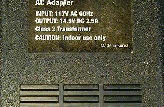 A close up of the rating information on the power supply.