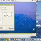 A capture of the whole of my Powerbook's screen, showing Castle Link inside Windows XP-Pro, on the Mac desktop!