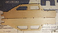 Name: 20191126_152436.jpg Views: 19 Size: 1.13 MB Description: sides with the plastic windows placed and drying.  Note to take care that you glue both on the Inside of the fuse, which means paying attention to the side orientations.