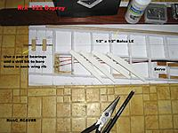Name: Wing_010.jpg Views: 55 Size: 248.7 KB Description: A bearing / drill bit jig used to correctly drill thru each wing rib for rotation rods .