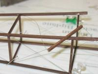 Name: Fuse rigging.jpg Views: 395 Size: 29.4 KB Description: Kevlar thread being built into the balsa frame.