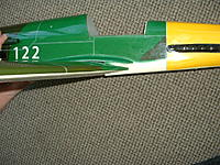 Name: DSCF0004.JPG Views: 60 Size: 132.1 KB Description: The glued on wing fillets are thin plastic, But should Not have been glued on the fuse at the factory, As you can see, There will be a wrong gap when wing is installed.