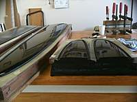 Name: WingGloss2.jpg Views: 1348 Size: 28.4 KB Description: Note the wing joiner mould being clamped in the background.
