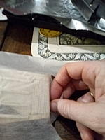 cut and make tabs so that it can go around the edge without creasing.