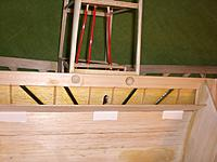 Name: Carbon reinforcement under flap.jpg Views: 175 Size: 170.8 KB Description: Once I realized how very little wood there was between those mounting screws and the forward edge of the flap bay, well, carbon and epoxy to the rescue.