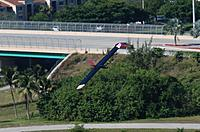 Name: DSC_4595 (Large).jpg Views: 64 Size: 188.3 KB Description: M60 turns with Wiles Rd overpass in the background.