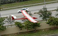 Name: D71_2484_DxO.jpg Views: 38 Size: 266.8 KB Description: Larry's plane on approach.