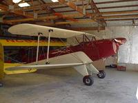Name: Bucker in hangar.jpg