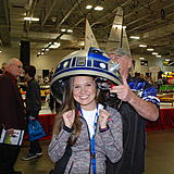 I stopped back by the R2 Table and I got to try on R2's head!