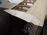 Name: DSCF8789.jpg Views: 22 Size: 1.01 MB Description: The top tip sheeting is glued in place and taped while it cures.
