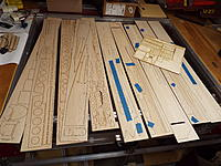 """Name: DSCF8807.jpg Views: 41 Size: 1.44 MB Description: Laser cut kit takes 4 sheets of 1/8"""", 5 sheets of 3/32"""", 1 sheet of 1/16"""", a 12 x 12 sheet of Lite Ply, and a post card of 1/16"""" ply.  And a bunch of 3/16"""" SQ and few 1/4"""" sq sticks."""