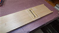 Name: DSCF1381.JPG Views: 28 Size: 2.77 MB Description: The hole in the bottom sheeting will allow me to have the retainer straps against hard wood without have to countersink them through the balsa.