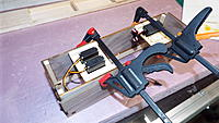 """Name: DSCF1410.JPG Views: 36 Size: 2.85 MB Description: The servo trays are glued and clamped.  The 1/4"""" rails are flush with the bottom, setting the servo height to align properly with the pushrod exits that were laser cut into the front and real panels."""