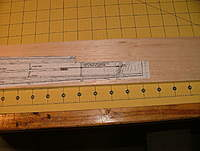 Name: dscf8810.jpg Views: 228 Size: 83.7 KB Description: Showing the tail end of the pattern with the reference line from the nose.  Note that we cut out the notch for the stab.  This will ensure that it has the right incidence.