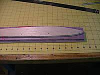 """Name: dscf8826.jpg Views: 251 Size: 75.0 KB Description: I sliced the 2"""" thick foam lengthwise to get 2 rough 1"""" sheets.  Spray the glue (lightly!) onto the OUT OUTER SURFACE of the foam.  That side will be much smoother, and adhere better to the balsa.  Also, REMOVE PLANS PAPER FROM WOOD!"""