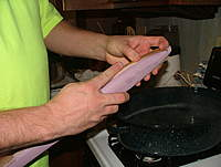"""Name: dscf8850.jpg Views: 376 Size: 69.7 KB Description: Notice the lumps in the nose between my fingers.  This is saying that the wood is too stiff for the bend.  I used common balsa, not the """"good stuff"""", so I'm not surprised.  I had to slice the nose about 4-6"""" in two places to get the wood to"""