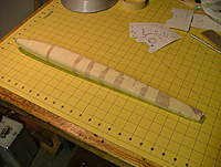 Name: dscf8853.jpg Views: 363 Size: 101.8 KB Description: So like any good modeler I had to improvise.  After the wood cooled a bit and a lot of the moisture was gone (2 hours in the previous wrappings), I removed the rags and securely taped the balsa to the form.