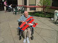 Name: DSCF3973.jpg Views: 134 Size: 771.3 KB Description: Ellis with Grandpa 93 3/4 in May 2007.  He was in a nursing home recovering from a stay in the hospital when he covered this plane.  He had built it a few weeks before.