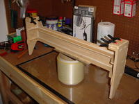 Name: Hood5.jpg Views: 717 Size: 90.0 KB Description: Glued, clamped, and drying the top hinge supprts