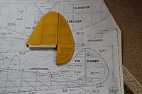 Name: PIX 045.jpg Views: 269 Size: 270.0 KB Description: Rudder/stab laid against the Cloud Cruiser plan for comparison
