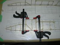 Name: DSCN1821.jpg Views: 906 Size: 82.1 KB Description: Building on top of plans. Pin, glue, clamp, wait, repeat...