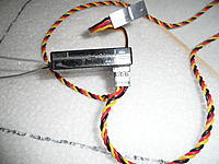 Name: SAM_1226.jpg Views: 226 Size: 173.1 KB Description: Note the bulge that is formed by the wires when connected to the Rx.