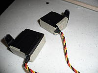 Name: SAM_1237.jpg Views: 209 Size: 97.7 KB Description: Covering the sides of the servos with masking tape. They were installed by gluing them to their cavities using Zap Goo.