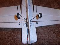 """Name: P4081591web.jpg Views: 25 Size: 312.0 KB Description: CF spar seen just behind servos...  note 1"""" triangles top and bottom to make a nose block.. wheel legs through the fuzz braced with small EPP blocks seem strong enough so far.. 1mm CF rods bracing.. and odd flats to reinforce the various control surf"""