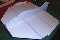 Name: P9211659.jpg Views: 1 Size: 229.9 KB Description: wing tip fins are a bit smaller this time using some scrap foam.. they are not critical for size, they do however straighten and strengthen the wing..  two 5mm flat spars, the front spar is on the established 25% COG line