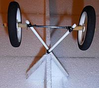 Name: P9211664.jpg Views: 8 Size: 182.9 KB Description: wheel setup ..X hot glued to EPP triangles ..legs are 4mm Fibreglass curtain rods..