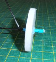 Name: P2020115.jpg Views: 251 Size: 75.5 KB Description: depron wheel with a tube hub on a 1.5mm rod U/C..restained with another bit of the tube glued in place..using a long hub tube the wheels dont wobble if the rod U/C is too thin