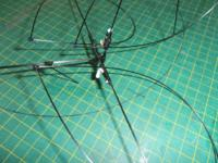 Name: P2020122.jpg Views: 262 Size: 147.9 KB Description: tail plane halves and fin get lashed to the stubbs in the tail assembly... make sure they are all lined up, square and even, as needed before you add the CA glue to fix them fully