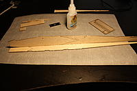 Name: IMG_2163.JPG Views: 90 Size: 2.77 MB Description: Next, glue a side onto the fuselage bottom. Make sure you get the sides correct. The one with the high slot in the rear goes on the left, the side with the lower slot goes on the right. Just glue the straight center section in place for now. No the tail.