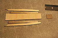 Name: IMG_2172.JPG Views: 84 Size: 2.91 MB Description: Grab the longest crossgrain piece of balsa, the little canopy rails from the fuselage, and your sheet of 1/64 ply. Assemble as shown.