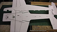 Name: IMG_1170.jpg Views: 117 Size: 116.0 KB Description: Flip the Fuse over and install servos and aileron pushrods.