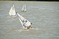 Name: frostbite regatta.jpg Views: 235 Size: 111.6 KB Description: Big puffs on the downwind were hard to see coming!