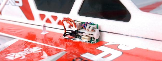 Spektrum AR 6400L receiver/ESC/servo unit.