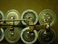 Name: DSC04416.jpg Views: 293 Size: 84.8 KB Description: The second tap wire (white) can go anywhere on the + or - side of the last 4 cells.  Notice the black tap wire from the other side coming through the open space between the cells.
