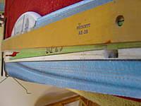 Name: DSC00196.jpg Views: 282 Size: 55.8 KB Description: Cutting the rudder servo wire channel