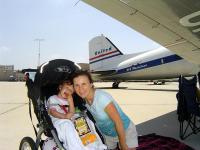 Name: DSC01605.jpg Views: 586 Size: 45.4 KB Description: My family setting up for a picnic on the flightline, shaded by the wing of this beautiful DC-3.