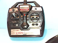 Name: Heli 005.jpg Views: 21 Size: 173.1 KB Description: Transmitter is light weight and EZ to use.  All you have to do is select the Mode 1 or 2 for trottle.