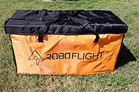 Name: Roboflight case.jpg Views: 0 Size: 3.05 MB Description: Here is a complete picture of the size and shape of the carrying bag for 2 wings.  Ideal for Jet wings that are shorter.  Lot of room and padded!