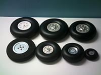 Name: Wheels.JPG Views: 11 Size: 5.9 KB Description: Common low bounce tires with metal bubs and nylon bearings.