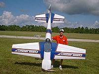 Name: anthony_greco_40cap-1.jpg Views: 203 Size: 26.9 KB Description: Original builder and respected Pilot from Ft. Myers Tony Grego made this plane do everything in the book. You can hang it on the prop too!