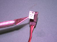 Name: thumb-DSCF0015[1].jpg Views: 159 Size: 4.9 KB Description: Transfer the lables to the plugs using the point of the #11 Exacto blade and don't touch the sticking back for best results.