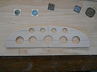Name: thumb-DSCN3683[1].jpg Views: 218 Size: 5.2 KB Description: Here is  panel already drilled out with the instruments rough cut to fin inside the holes.