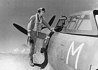 """Name: 15219869082_2bbc0c3f57_o.jpg Views: 9 Size: 217.1 KB Description: Great reference shot of a sister P-47 to """"Big Squaw"""" and its pilot in Pacific Theater khakis.  Note also the gun sight and interior bulletproof glass frame."""