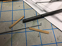 Name: IMG_4854.jpg Views: 10 Size: 579.1 KB Description: Pushrod for rudder -- salvaged CF arrow shaft,  wire, dowel sections to force wire to inside wall of CF.  Epoxied in.