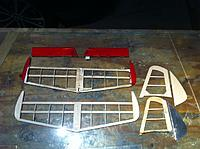 """Name: photo.JPG Views: 33 Size: 498.0 KB Description: Of course I started the project making the empennage pieces. The horizontal stab has an airfoil. I just rough guessed it with a sanding long bar.  The new ones are lighter. I did use 1/16"""" laminate for the stringers as did the original builder."""