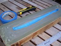 Name: molds 001.jpg Views: 903 Size: 88.7 KB Description: Blue masking tape laid into mold cavity.